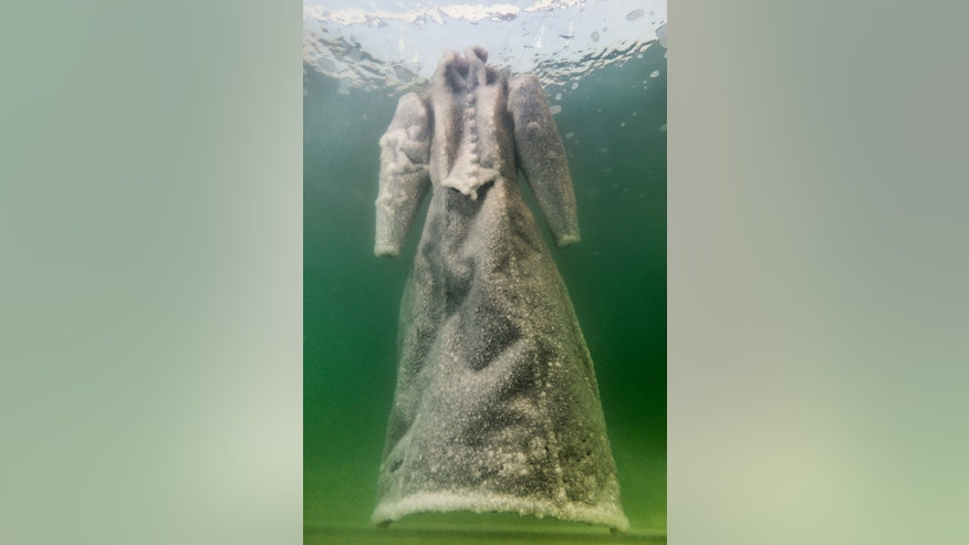 A picture of the dress submerged in the Dead Sea, courtesy the artist and Marlborough Contemporary, London. (Photo: Studio Sigalit Landau)