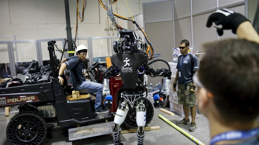 File photo: The Team IHMC Robotics Atlas 'Running Man' robot built by Boston Dynamics is readied in the team garage during the finals of the Defense Advanced Research Projects Agency (DARPA) Robotic Challenge in Pomona, California June 6, 2015. (REUTERS/Patrick T. Fallon)