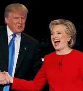 Republican U.S. presidential nominee Donald Trump shakes hands with Democratic U.S. presidential nominee Hillary Clinton at the conclusion of their first presidential debate at Hofstra University in Hempstead, New York, U.S., September 26, 2016. REUTERS/Mike Segar     TPX IMAGES OF THE DAY      - RTSPKQT