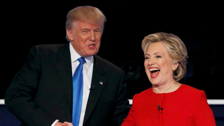 Republican U.S. presidential nominee Donald Trump shakes hands with Democratic U.S. presidential nominee Hillary Clinton at the conclusion of their first presidential debate at Hofstra University in Hempstead, New York, U.S., Sept. 26, 2016. (REUTERS/Mike Segar) T