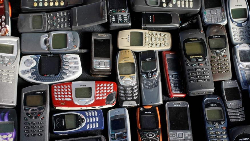 A collection of mobile phones made by Nokia is pictured in this file photo illustration, May 8, 2012. (REUTERS/Kacper Pempel/Illustration/File Photo)