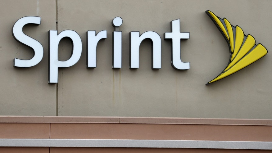 A Sprint store logo is pictured on a building in Boca Raton, Florida March 19, 2016. (REUTERS/Carlo Allegri)