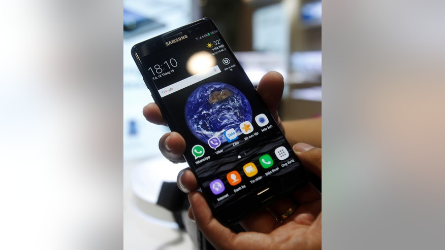 A man holds his mobile phone Samsung Galaxy Note 7 at a mobile phone shop in Hanoi, Vietnam October 12, 2016.