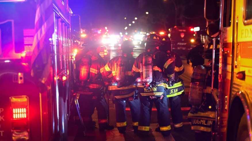 New York City firefighters stand near the site of an explosion in the Chelsea neighborhood of Manhattan, New York, U.S. September 17, 2016. (REUTERS/Rashid Umar Abbasi)