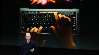 Apple CEO Tim Cook speaks under a graphic of the new MacBook Pro during an Apple media event in Cupertino, California, U.S. October 27, 2016.    REUTERS/Beck Diefenbach   TPX IMAGES OF THE DAY - RTX2QR68