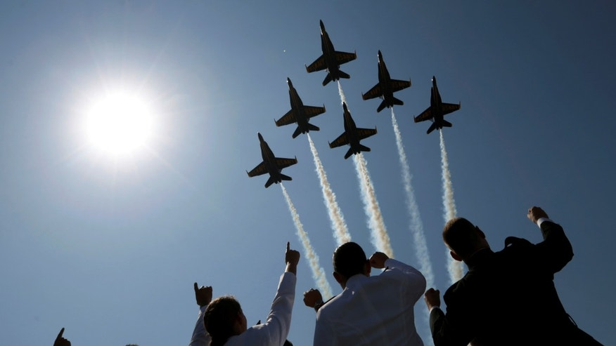 The Blue Angels perform a fly-over at the start of the graduation and commissioning ceremony at the U.S. Naval Academy in Annapolis, Maryland U.S. May 27, 2016. REUTERS/Kevin Lamarque - RTX2EHRZ