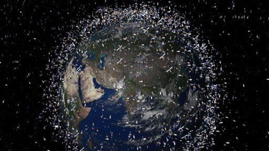 This is a computer-generated image provided by the European Space Agency of catalogued objects in low-Earth orbit viewed over the Equator. Scientists are keeping a close eye on orbital debris created when two communications satellites smashed into each other Tuesday Feb. 10, 2009.