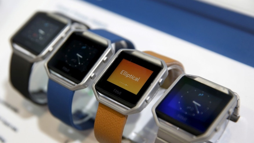 Fitbit Blaze watches are displayed during the 2016 CES trade show in Las Vegas, Nevada January 6, 2016. (REUTERS/Steve Marcus/File Photo)