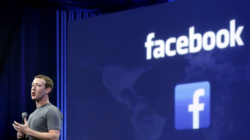 File photo - Facebook CEO Mark Zuckerberg speaks during his keynote address at Facebook F8 in San Francisco, California March 25, 2015. (REUTERS/Robert Galbraith) -
