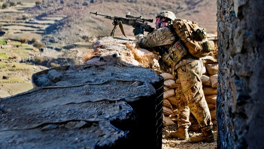 U.S. Army Sgt. Andrew Barnett armed with the M14 enhanced battle rifle outside an Afghan border police observation point in Kunar province, Afghanistan (U.S. Army photo by Sgt. Jon Heinrich)