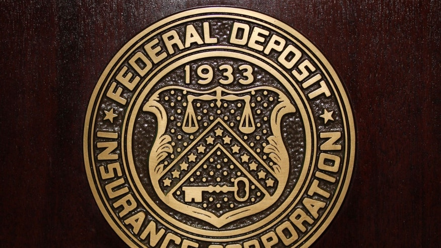 File photo - The Federal Deposit Insurance Corp (FDIC) logo is seen at the FDIC headquarters in Washington, Feb. 23, 2011. (REUTERS/Jason Reed)