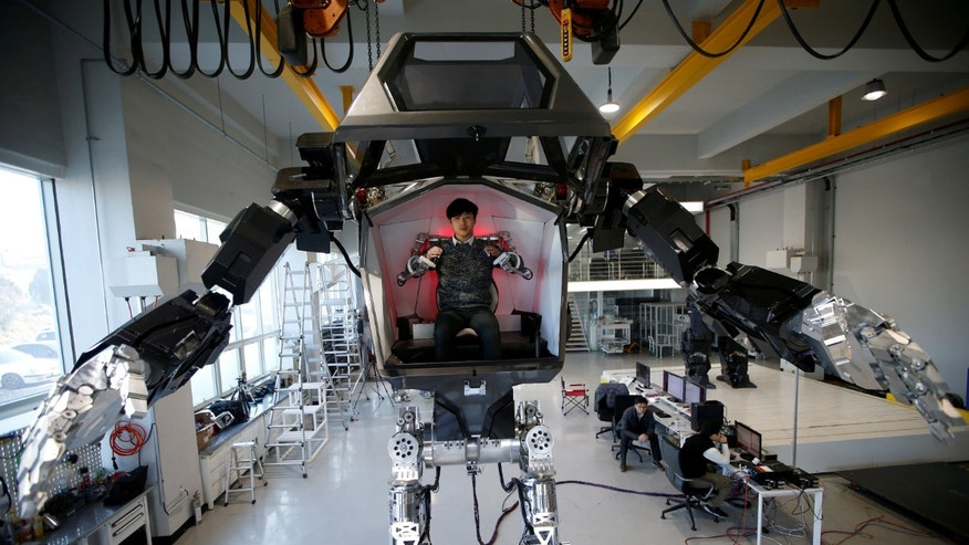 "An employee controls the arms of a manned biped walking robot ""METHOD-2"" during a demonstration in Gunpo, South Korea, December 27, 2016. (REUTERS/Kim Hong-Ji)"