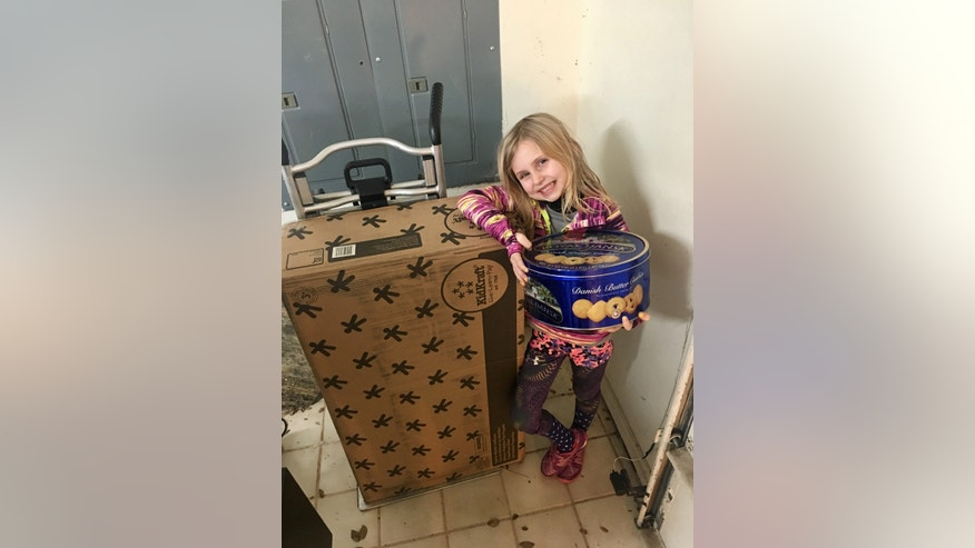 6-year-old Brooke Neitzel with the dollhouse and cookies she accidentally ordered via Amazon's Alexa (Megan Neitzel).