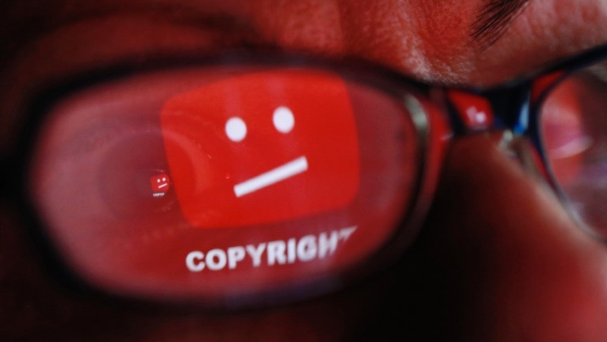 A picture illustration shows a YouTube error logo reflected in a person's eye, in central Bosnian town of Zenica, early June 18, 2014.  (REUTERS/Dado Ruvic)