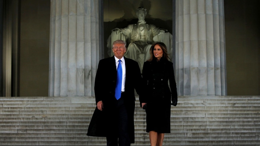 U.S. President-elect Donald Trump and his wife Melania take part in a Make America Great Again welcome concert at the Lincoln Memorial in Washington, U.S. Jan. 19, 2017. (REUTERS/Jonathan Ernst)
