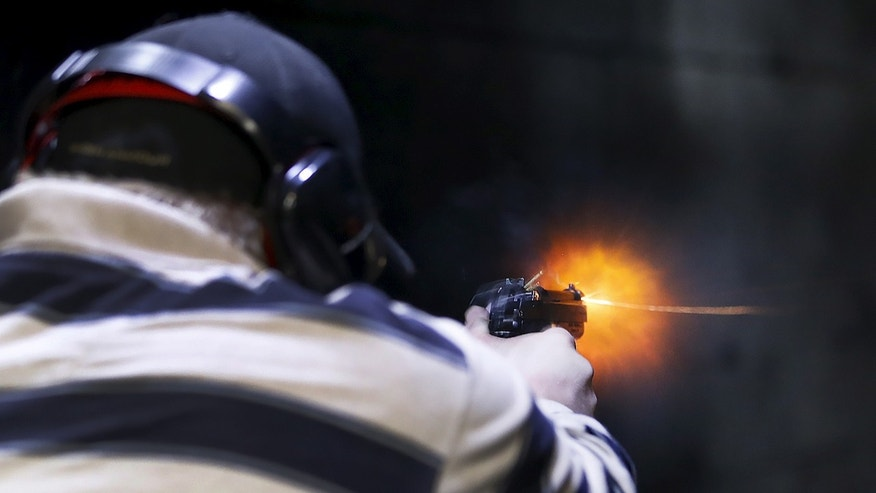 File photo: A man fires a Sig P320 handgun at the Ringmasters of Utah gun range, in Springville, Utah on December 18, 2015. (REUTERS/George Frey)