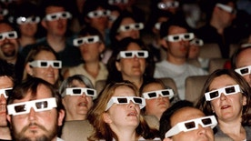 An audience watches a film through 3D spectacles at the launch screening of The National Film Theatre 3D film season, August 8. The season will run through September and include the films 'Jaws 3D' and 'It Came From Outer Space'. - RTXGMNP