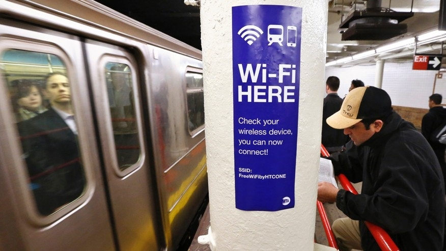 File photo: A sign advertises Wi-Fi service in the Times Square Subway station in New York, April 25, 2013.