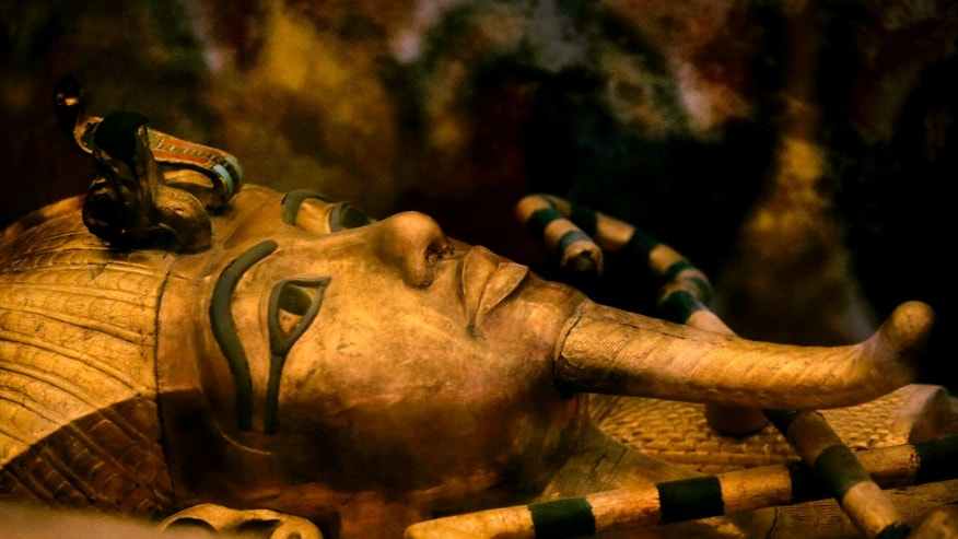 FILE - In this Thursday, Nov. 5, 2015 file photo, Egypt's famed King Tutankhamun's golden sarcophagus is displayed at his tomb in a glass case at the Valley of the Kings in Luxor. (AP Photo/Amr Nabil)
