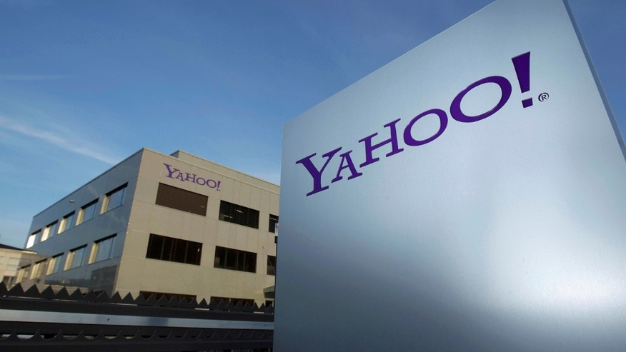 A Yahoo logo is pictured in front of a building in Rolle, 19 miles east of Geneva, Dec. 12, 2012. (REUTERS/Denis Balibouse/File photo)