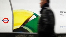 A man walks past a poster for Google's Chrome browser in an underground station in central London January 25, 2010.  REUTERS/Luke MacGregor      (BRITAIN - Tags: BUSINESS) - RTR29J7L