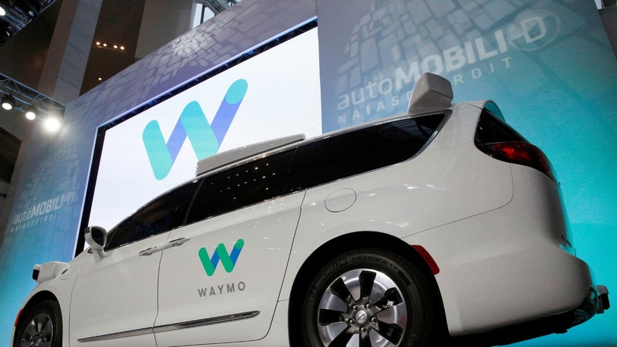 File photo - Waymo unveils a self-driving Chrysler Pacifica minivan during the North American International Auto Show in Detroit, Michigan, U.S., Jan. 8, 2017. (REUTERS/Brendan McDermid)