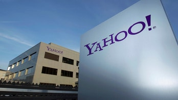 A Yahoo logo is pictured in front of a building in Rolle, 30 km (19 miles) east of Geneva, December 12, 2012.   REUTERS/Denis Balibouse/File photo   - RTSP1GX