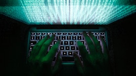 "A man types on a computer keyboard in Warsaw in this February 28, 2013 illustration file picture. One of the largest ever cyber attacks is slowing global internet services after an organisation blocking ""spam"" content became a target, with some experts saying the disruption could get worse.        To match INTERNET-ATTACK/      REUTERS/Kacper Pempel/Files (POLAND - Tags: BUSINESS SCIENCE TECHNOLOGY) - RTXXZVX"