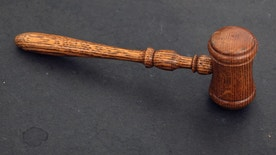 The judge's gavel is seen in court room 422 of the New York Supreme Court at 60 Centre Street February 3, 2012.  Picture taken February 3, 2012.  REUTERS/Chip East (UNITED STATES - Tags: CRIME LAW) - RTR2XRP1