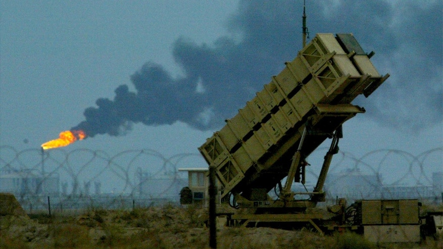 File photo - U.S manned Patriot missiles protect a nearby British and U.S airbase in front of the oilfields in Kuwait March 16, 2003. (REUTERS/Russell Boyce)