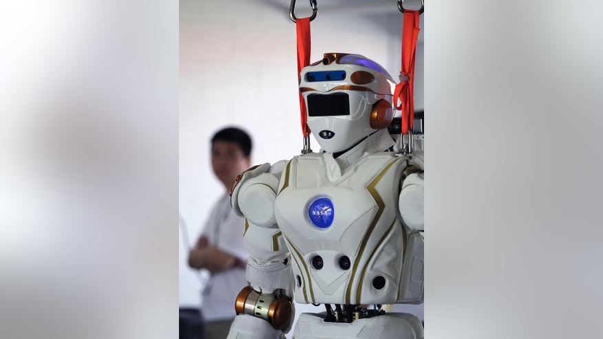 File photo - The NASA-JSC Valkyrie robot is seen in the team's work area, between tasks in Homestead, Florida Dec. 20, 2013. (REUTERS/Andrew Innerarity)