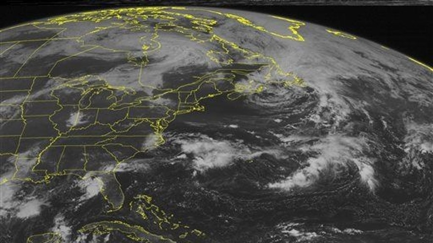 Storm over Hudson Bay spreads clouds across much of eastern Canada and down into the Upper Great Lakes.
