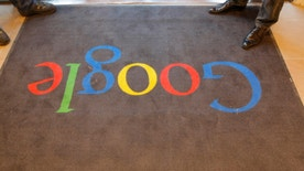 A Google carpet is seen at the entrance of the new headquarters of Google France before its official inauguration in Paris, France December 6, 2011. REUTERS/Jacques Brinon/Pool/File Photo - RTSFOFY