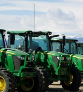 John Deere tractors are seen for sale at a dealer in Longmont, Colorado, U.S., February 21, 2017. REUTERS/Rick Wilking - RTSZOZE