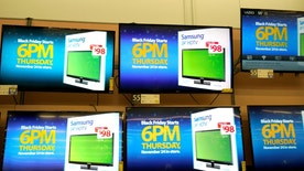 Advertisements of the upcoming Black Friday sales are seen on TV screens at a Walmart store in Westminster, Colorado, U.S. November 23, 2016. REUTERS/Rick Wilking - RTST05M