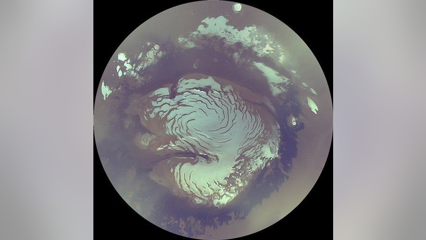 This image provided by NASA shows a view of the north polar ice cap on Mars taken by NASA's Mars Reconnaissance Orbiter.