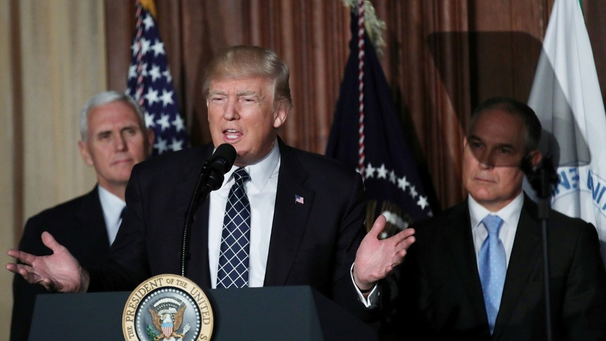 "File photo: U.S. President Donald Trump speaks between Vice President Mike Pence (L) and EPA Administrator Scott Pruitt prior to signing an executive order on ""energy independence,"" eliminating Obama-era climate change regulations, during an event at the Environmental Protection Agency (EPA) headquarters in Washington, U.S., March 28, 2017. (REUTERS/Carlos Barria)"