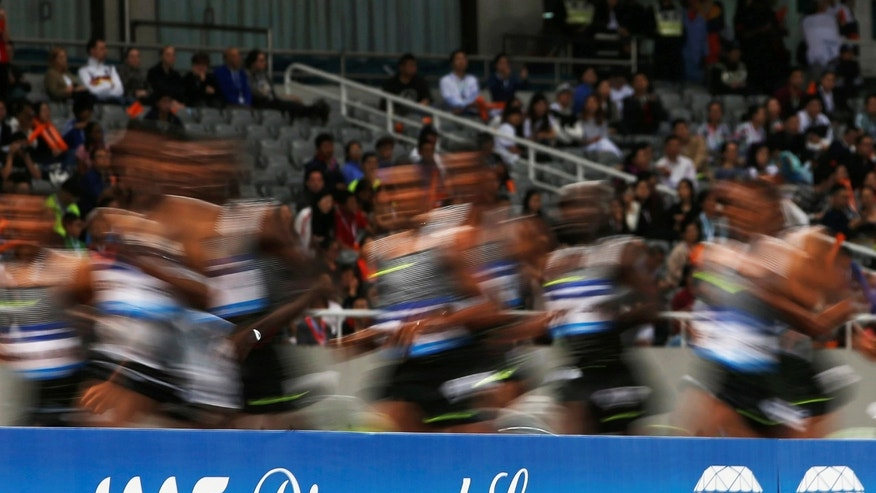 File photo - Athletes run past a Diamond League board during an IAAF Athletics Diamond League meeting in Shanghai Stadium, Shanghai, China on May 14 2016 (REUTERS/Aly Song).