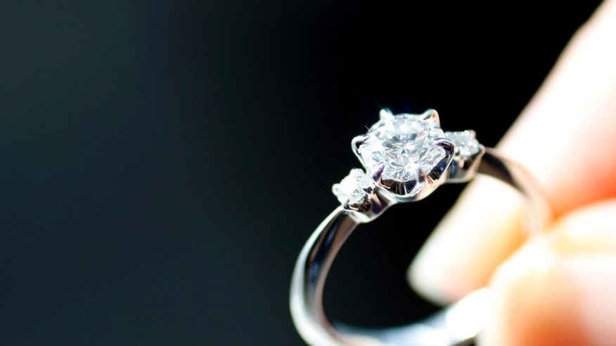 File photo - An engagement ring is displayed at a jewellery store in Tokyo June 2, 2009. (REUTERS/Yuriko Nakao)