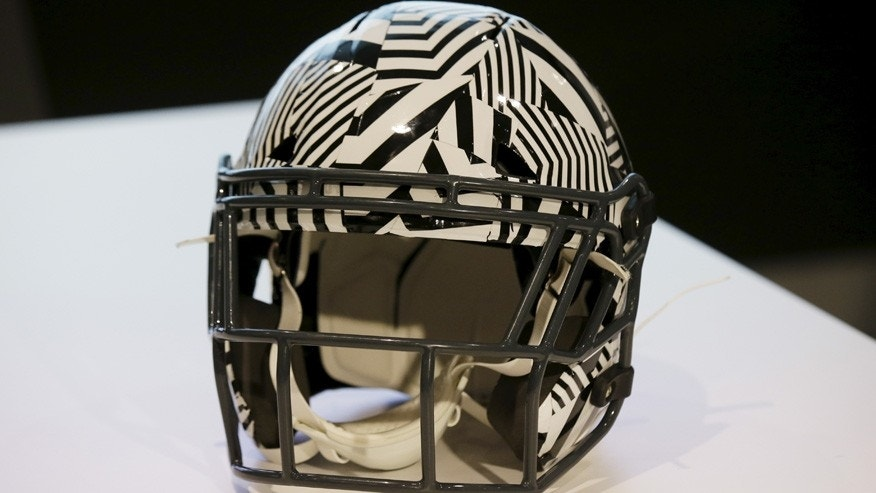 File photo: A new impact absorbing helmet is displayed at the NFL Headquarters in New York December 3, 2015. (REUTERS/Brendan McDermid)