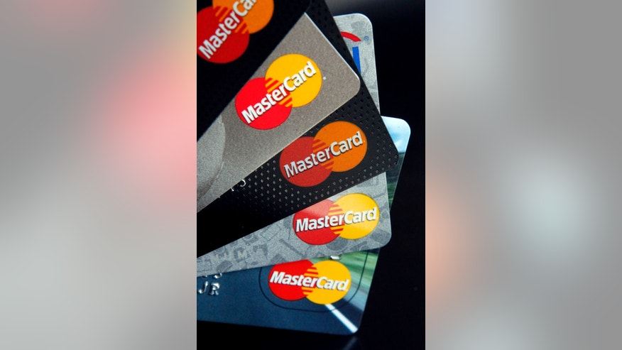 File photo: In this Thursday, April 25, 2013, photo, MasterCard credit cards are displayed for a photographer in Montpelier, Vt. (AP Photo/Toby Talbot)