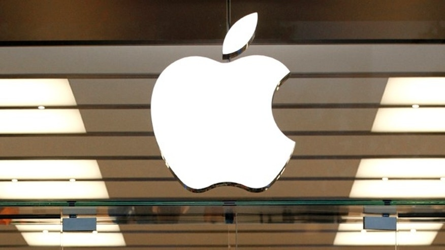 File photo: FILE - This Thursday, Sept. 19, 2013, file photo shows the Apple logo above a store location entrance, in Dallas.  (AP Photo/Tony Gutierrez)