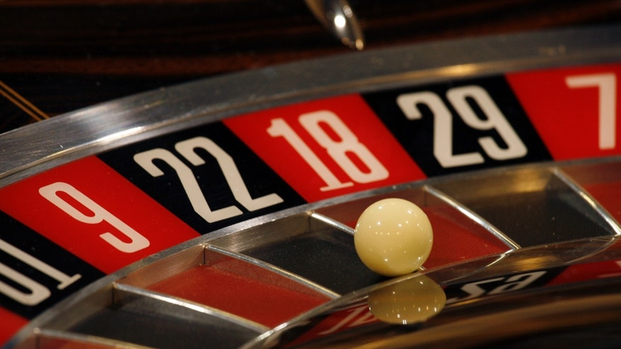 File photo - a roulette table is displayed during the Global Gaming Expo Asia in Macau June 2, 2009. (REUTERS/Bobby Yip)