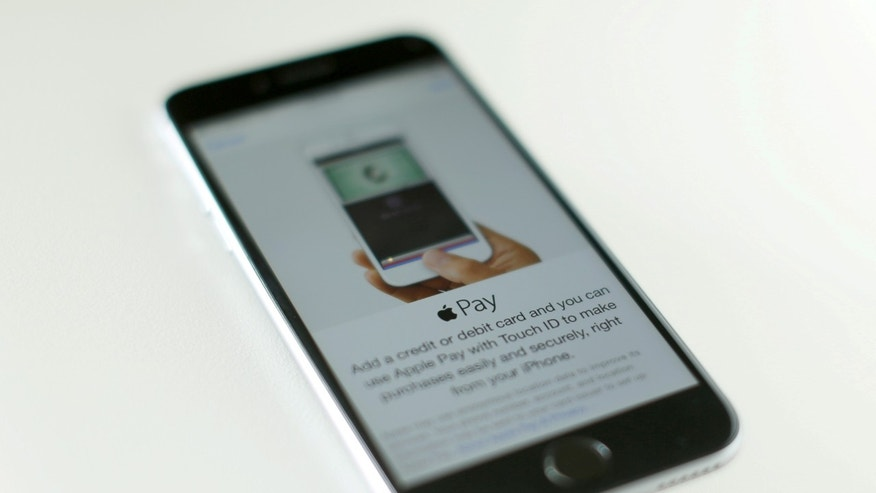 File photo: An Apple iPhone 6 with Apple Pay is shown in this photo illustration in Encinitas, California, U.S. June 3, 2015. (REUTERS/Mike Blake)