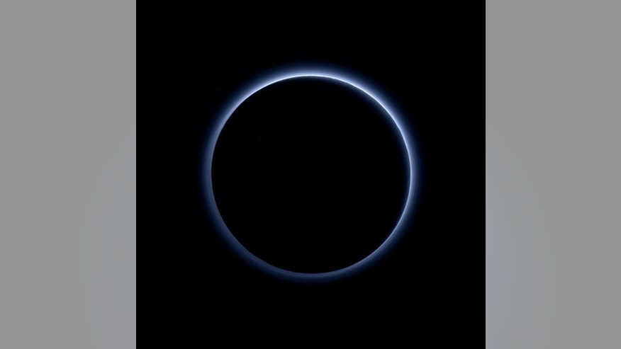 File photo-An occultation of Pluto and the sun, captured by the New Horizons spacecraft, reveals new information about the atmosphere — in this case, that Pluto has blue skies. The image was captured by the Ralph/Multispectral Visible Imaging Camera (MVIC  (NASA/JHUAPL/SwRI)