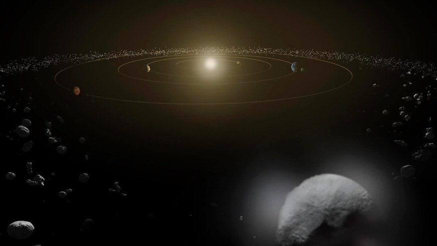 File photo: Dwarf planet Ceres is seen in the main asteroid belt, between the orbits of Mars and Jupiter, as illustrated in this undated artist's conception released by NASA January 22, 2014. (REUTERS/NASA/ESA/Handout via Reuters)
