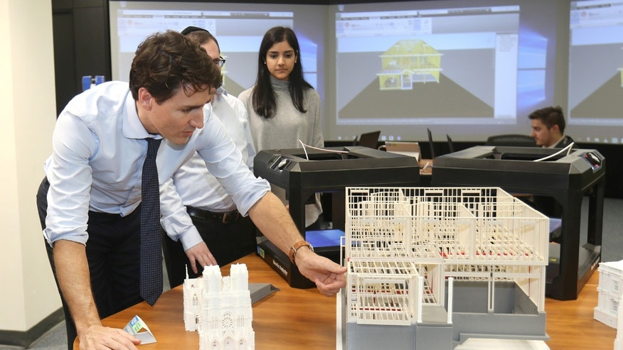File photo: Canada's Prime Minister Justin Trudeau looks at construction models created by 3D printers at the George Brown College Casa Loma campus in Toronto, Ontario, Canada March 23, 2017. (REUTERS/Fred Thornhill)