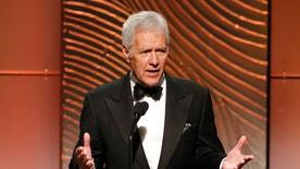 Jeopardy television game show host Alex Trebek speaks on stage during the 40th annual Daytime Emmy Awards in Beverly Hills, California June 16, 2013. REUTERS/Danny Moloshok (UNITED STATES - Tags: ENTERTAINMENT) - RTX10QIC