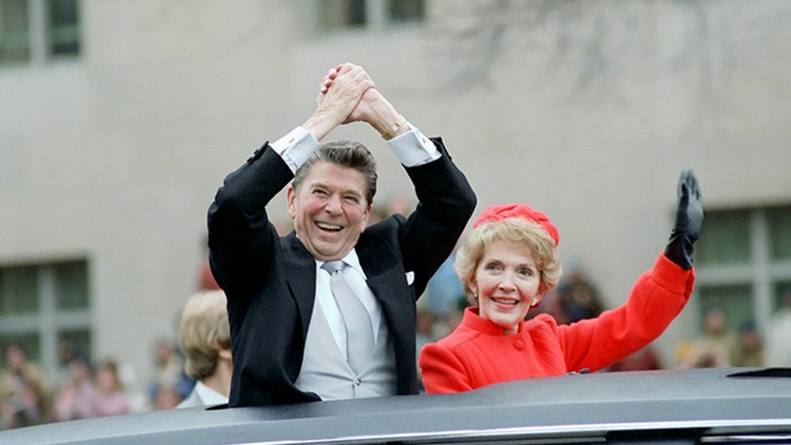 File photo: Ronald and Nancy Reagan wave from the limousine during their inaugural parade in Washington, D.C., U.S. in January 1981. (Ronald Reagan Presidential Library/Handout via REUTERS)