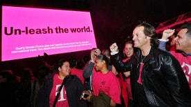 IN THIS IMAGE DISTRIBUTED BY AP IMAGES FOR T-MOBILE - T-Mobile CEO John Legere celebrates the end of international data roaming fees at a special event for customers with Shakira in New York's Bryant Park on Wednesday, Oct. 9, 2013. T-Mobile has extended unlimited data and texting to Simple Choice customers traveling in more than 100 countries. (Jason DeCrow/AP Images for T-Mobile)
